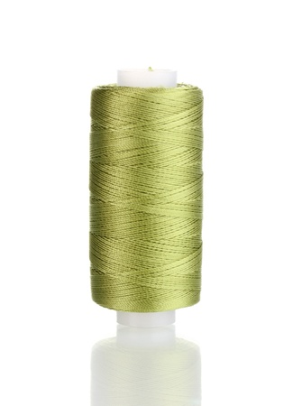 Green bobbin thread isolated on white photo