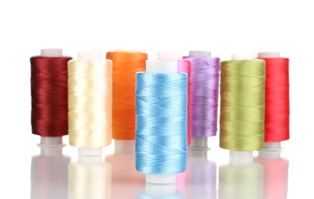 Many spools of thread isolated on white Stock Photo - 12731380