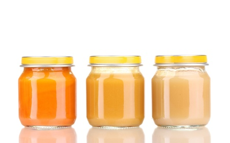 Jars of baby puree isolated on white photo