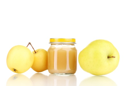 Jar of baby puree and apples isolated on white photo