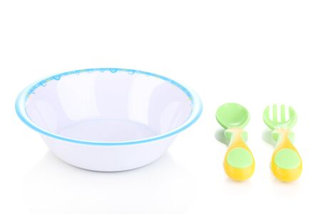 empty bowl: Baby plate with spoon and fork isolated on white Stock Photo
