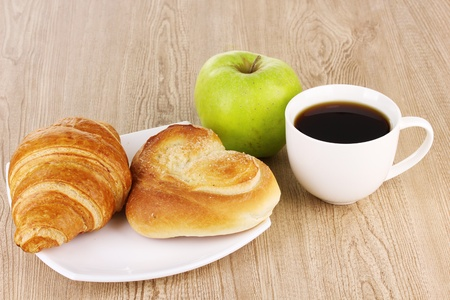 Classical breakfast. Coffee with croissant and bun photo