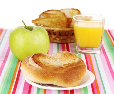 Classical breakfast. Orange juice and bun photo