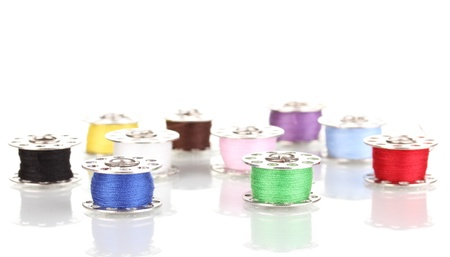 Metal spools of thread isolated on white photo