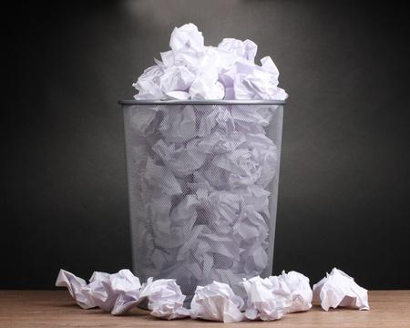 dustbin: Metal trash bin from paper on wooden floor on gray background