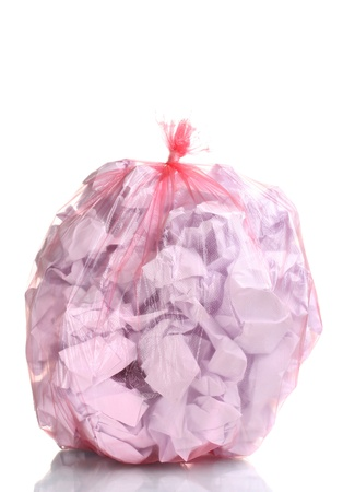 red garbage bag with trash isolated on white photo