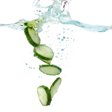 fresh sliced cucumber in water isolated on white