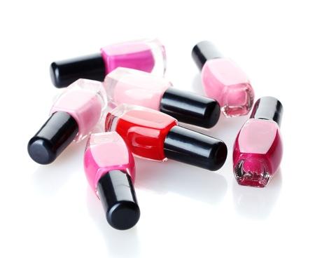 Group of nail polishes isolated on white photo