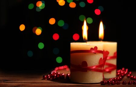 Beautiful candles on wooden table on bright background Stock Photo - 12824968