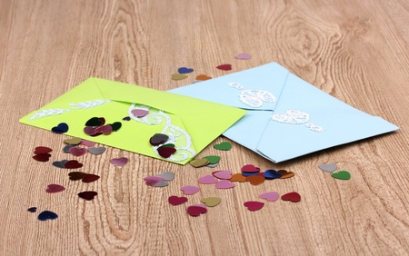 Color envelopes and confetti on wooden background Stock Photo - 12824804