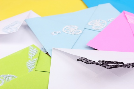 Bunch of color envelopes close-up on wooden background photo