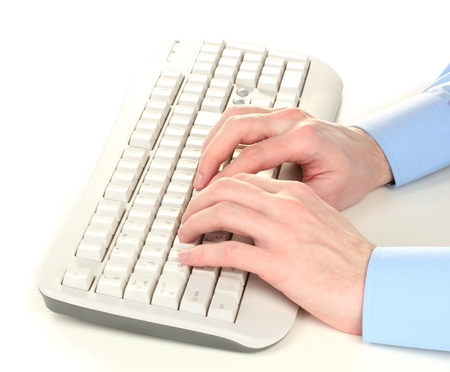male hands typing on the keyboard isolated on white photo