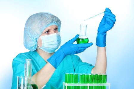 Young female scientist working in chemistry laboratory photo