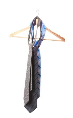 bright ties on wooden hanger isolated on white Stock Photo - 12825017