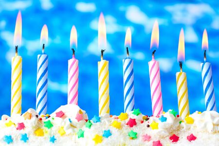 beautiful birthday candles  on blue background Stock Photo - 12824849