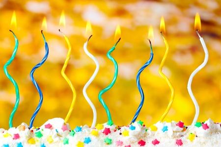 beautiful birthday candles  on yellow background photo