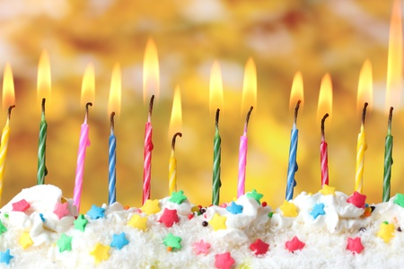 beautiful birthday candles  on yellow background Stock Photo - 12824848