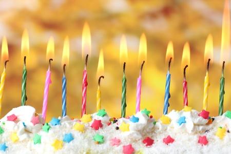 beautiful birthday candles  on yellow background Stock Photo - 12824848