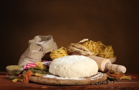 ingredients for homemade pasta on wooden table on brown background photo