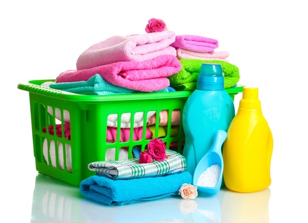 laundry basket: Detergents and towels in green plastic basket isolated on white