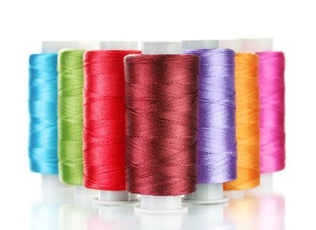 bright bobbin thread isolated on white  photo