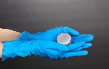 Uranium in hands on grey background Stock Photo - 12913290