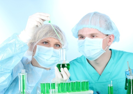 two scientists working in chemistry laboratory  Stock Photo - 12913836