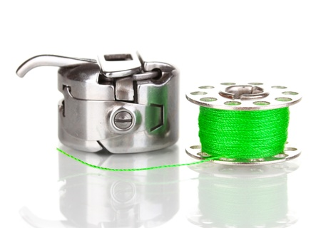bobbin: Metal spool of thread and sewing machine shuttle isolated on white Stock Photo