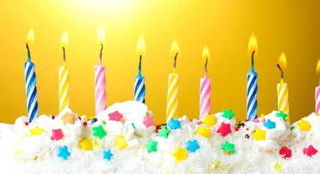 beautiful birthday candles  on yellow background photo