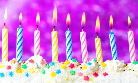 beautiful birthday candles  on purple background photo