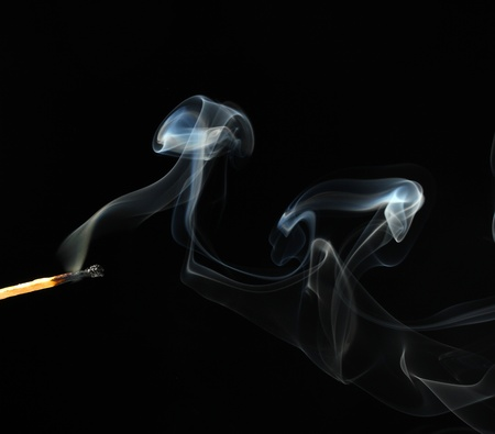 match with abstract smoke on black background photo
