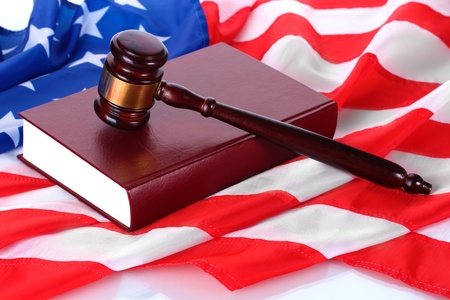 judge gavel and book on american flag background Stock Photo - 12915057