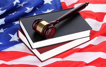 legal court: judge gavel and books on american flag background