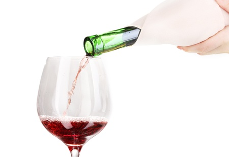 Pouring wine into wineglass isolated on white Stock Photo - 12912510