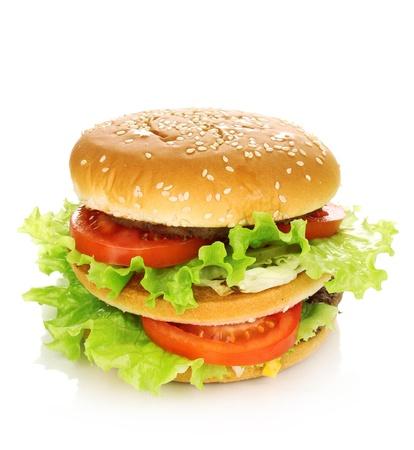 ajonjoli: Hamburguesa grande y sabroso aislado en blanco