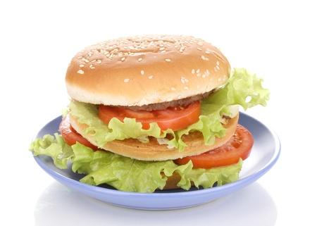 Big and tasty hamburger on plate isolated on white Stock Photo - 12913143