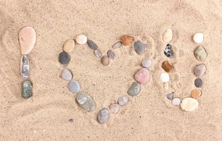 Love-stones on sand Stock Photo - 12915130
