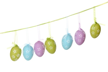 Colorful easter eggs hanging on ribbons isolated on white Stock Photo - 12912451