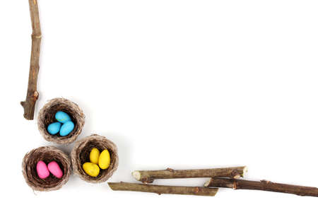 Colorful easter eggs in nests isolated on white Stock Photo - 12912873