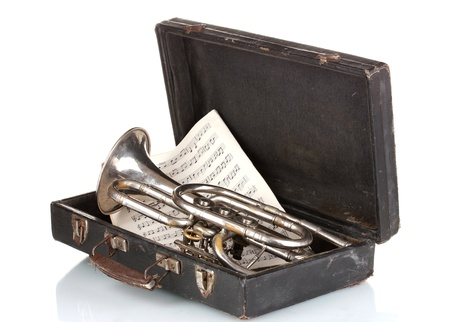 memorabilia: old trumpet and notebook with notes in case isolated on white