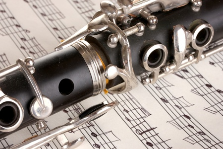 close up detail of clarinet and notebook with notes photo