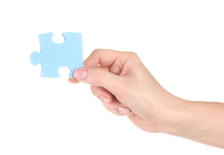 attached: Blue puzzle with a hand isolated on white Stock Photo