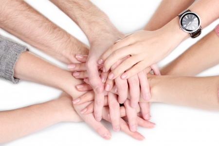 group of young people's hands isolated on white photo