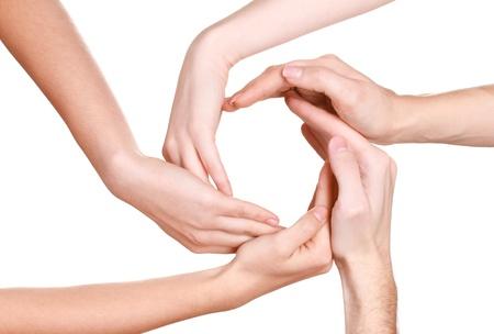 compromiso: grupo de las manos de los jóvenes aislados en blanco Foto de archivo