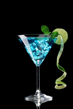 daiquiri alcohol: Blue cocktail in glass on black background