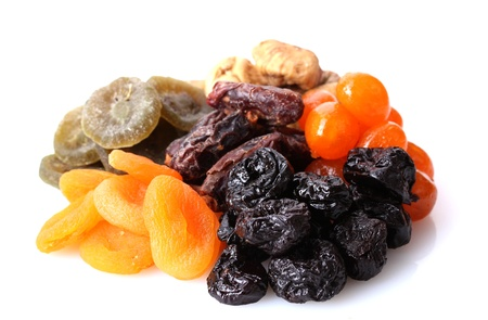 dried plums: Dried fruits isolated on white