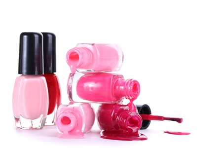 open bottles with bright nail polish isolated on white photo