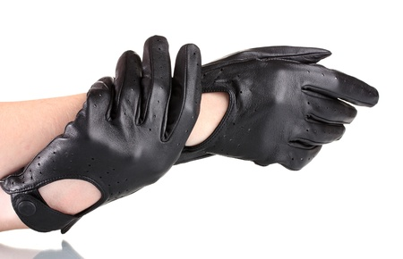 womens hands in black leather gloves isolated on white photo