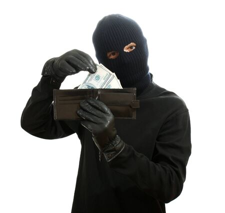 Bandit in black mask with stolen wallet isolated on white Stock Photo - 13082431