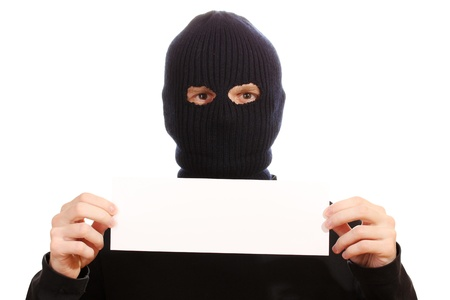 Bandit in black mask with blank card isolated on white Stock Photo - 13082963